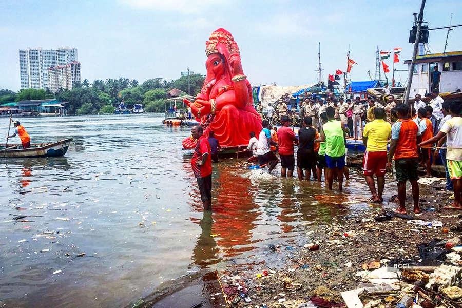 Volunteers clean up Versova beach after Ganesh Visarjan