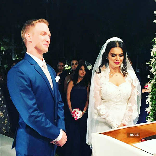 Aashka and Brent taking vows