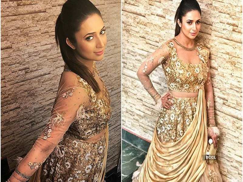 Sensuous in stylish gold and feather gown
