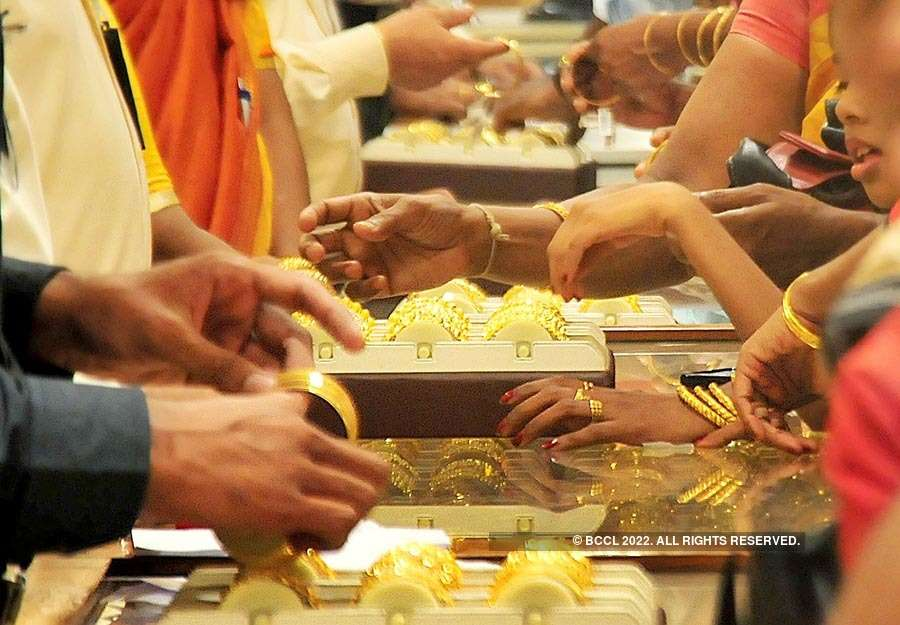 Gold loses sheen on subdued global cues, muted demand