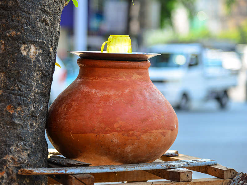 Matka (earthen pot) filled with water at a road side in India. Use of matka for storing drinking water especially in Summer is  an age old practice in India. It not only cools water without the use of electricity but also helps to naturally alkaline water especially mineral stripped water from RO filters.