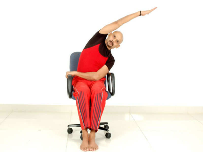9 yoga poses that you can do at your work desk | The Times of India