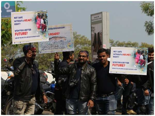 Bikers holding placards