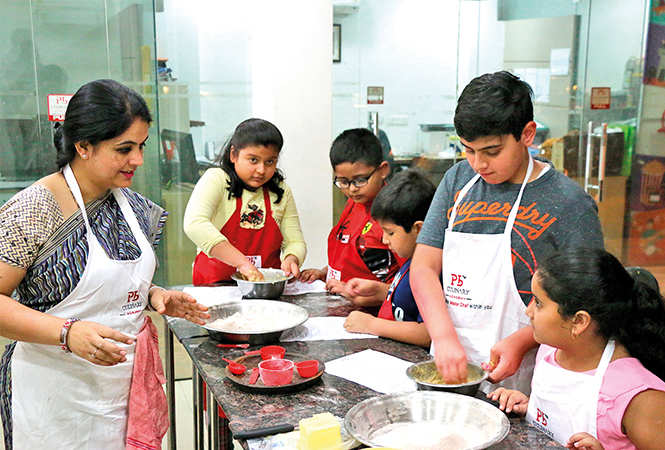 Kids learning new dishes at Pankaj Bhadouria's cookery class (BCCL/ Vishnu Jaiswal)