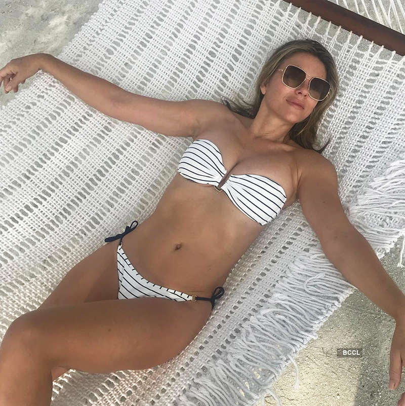 Bikini-clad Liz Hurley sets temperature soaring with her age-defying pictures