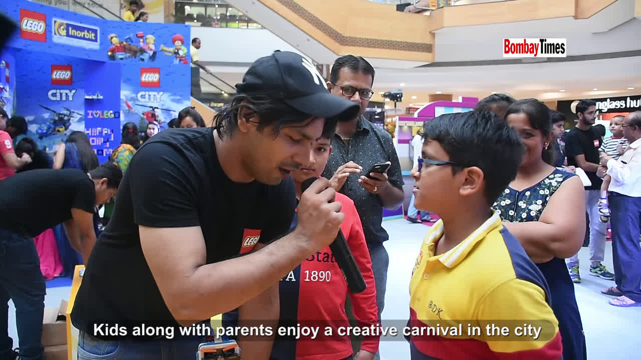 Kids along with parents enjoy a creative carnival in the city