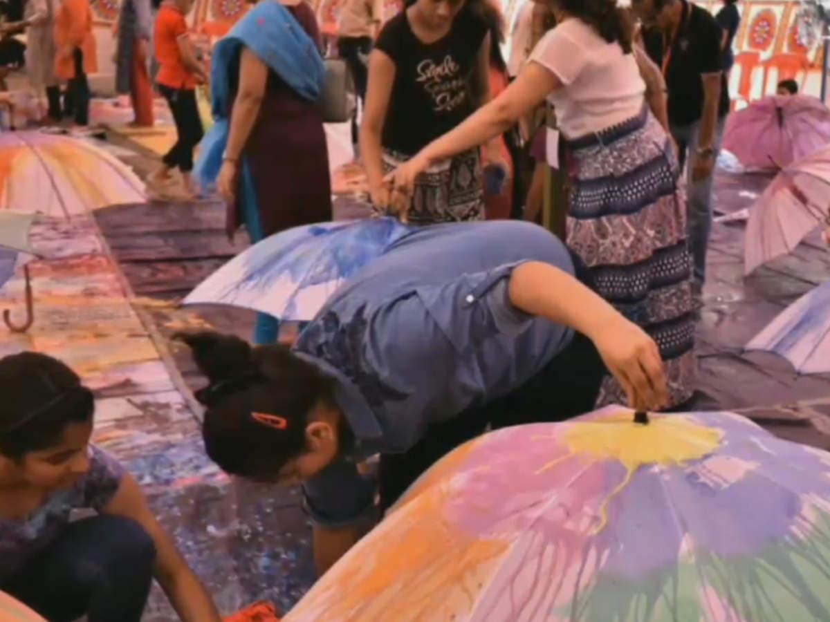 Mumbaikars enjoy painting their own colourful umbrellas