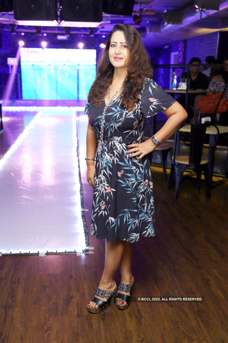 Socialites cheer for their team at Output, Bengaluru
