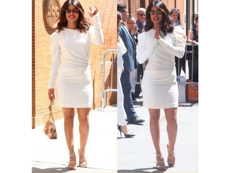 cced5c20a5 For promotions of an upcoming movie of hers, Priyanka went with this very  chic Isabel Marant white long-sleeved dress. Much like her Christian  Siriano gown, ...
