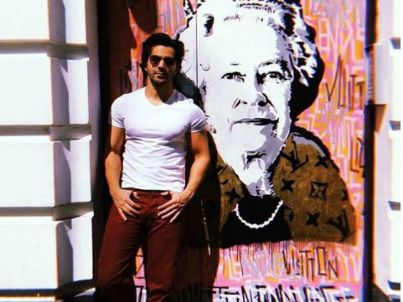 Varun Dhawan looks dapper while posing with the Queen of England