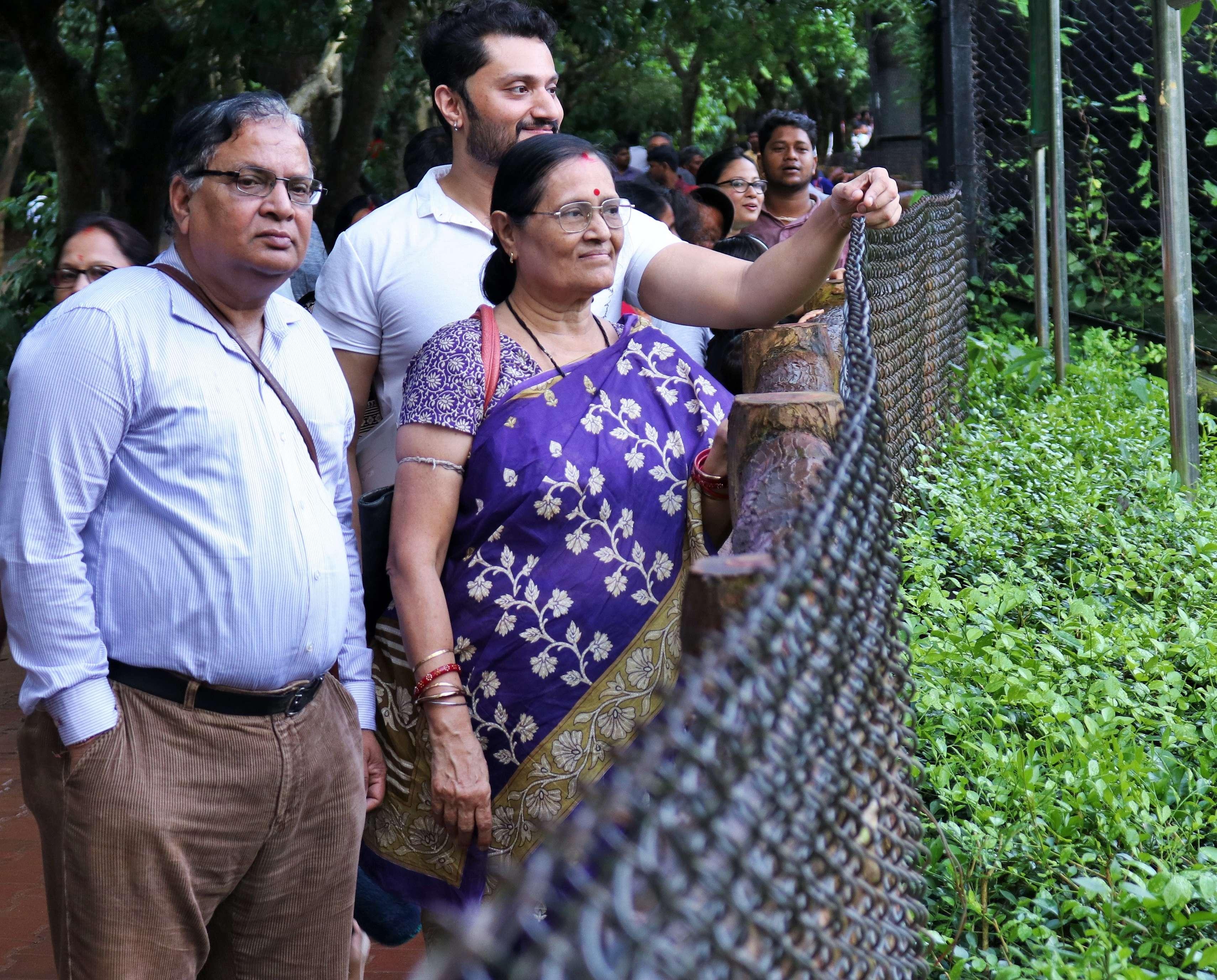 Chandan with his parents Ramakant Kar and Archana Mishra near the tiger enclosure - Copy