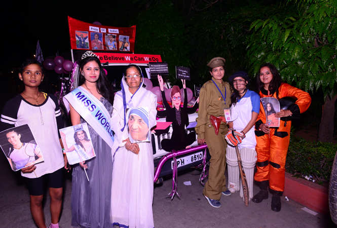 Participants of the car rally dressed as various women achievers