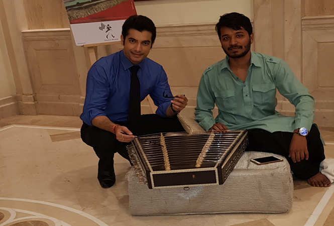 Ssharad posing with the Santoor player