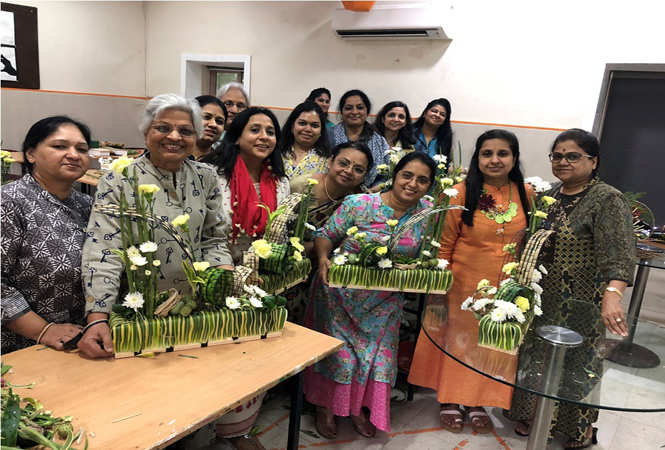 Participants posing with their creations
