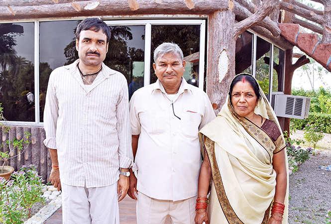 Pankaj Tripathi (L) with Lal Bihati Mritak, whose role he is essaying in the film, and his wife
