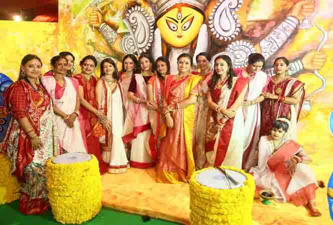 women decked up for teh puja