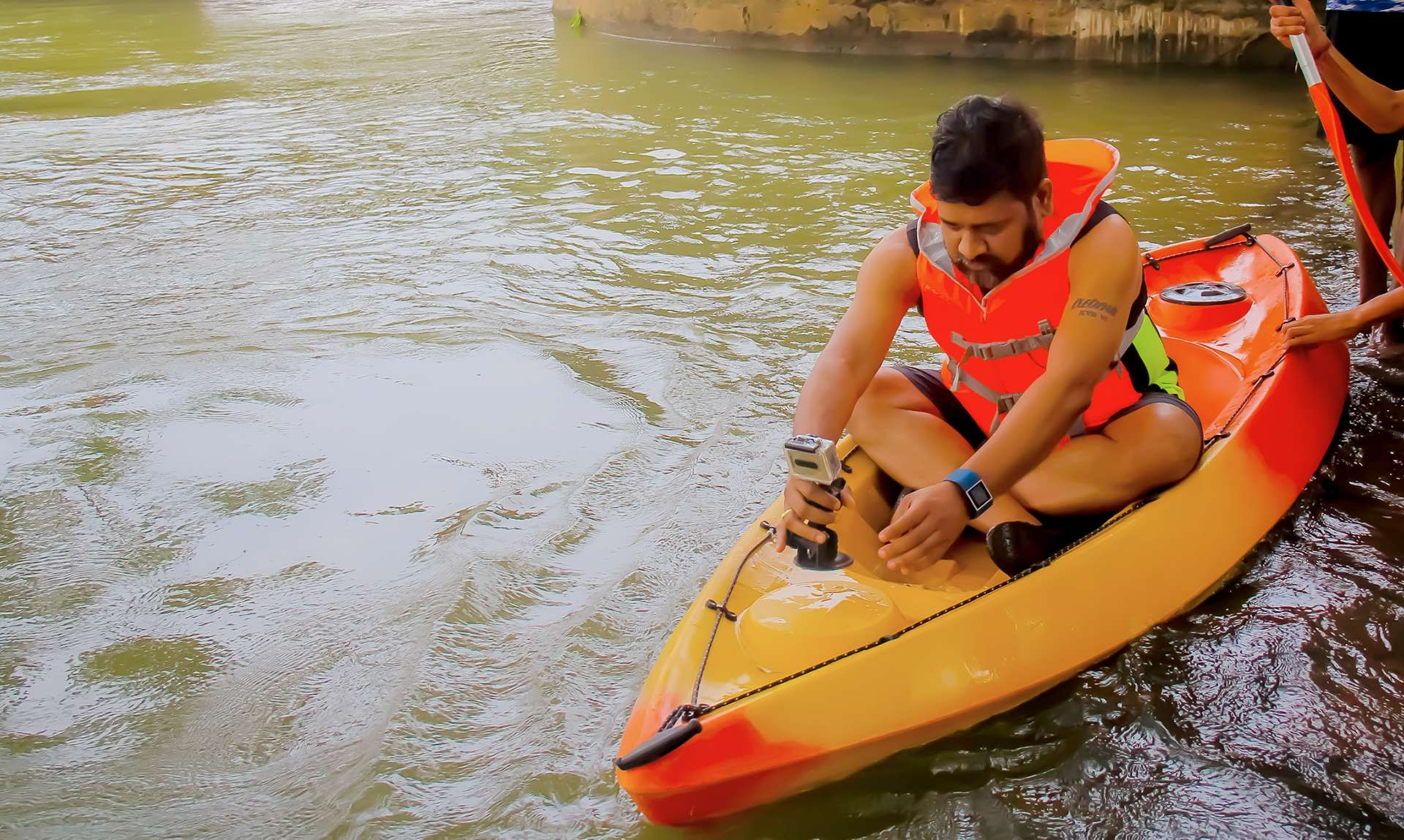 Debasish Sahu mounting a camera to his kayak