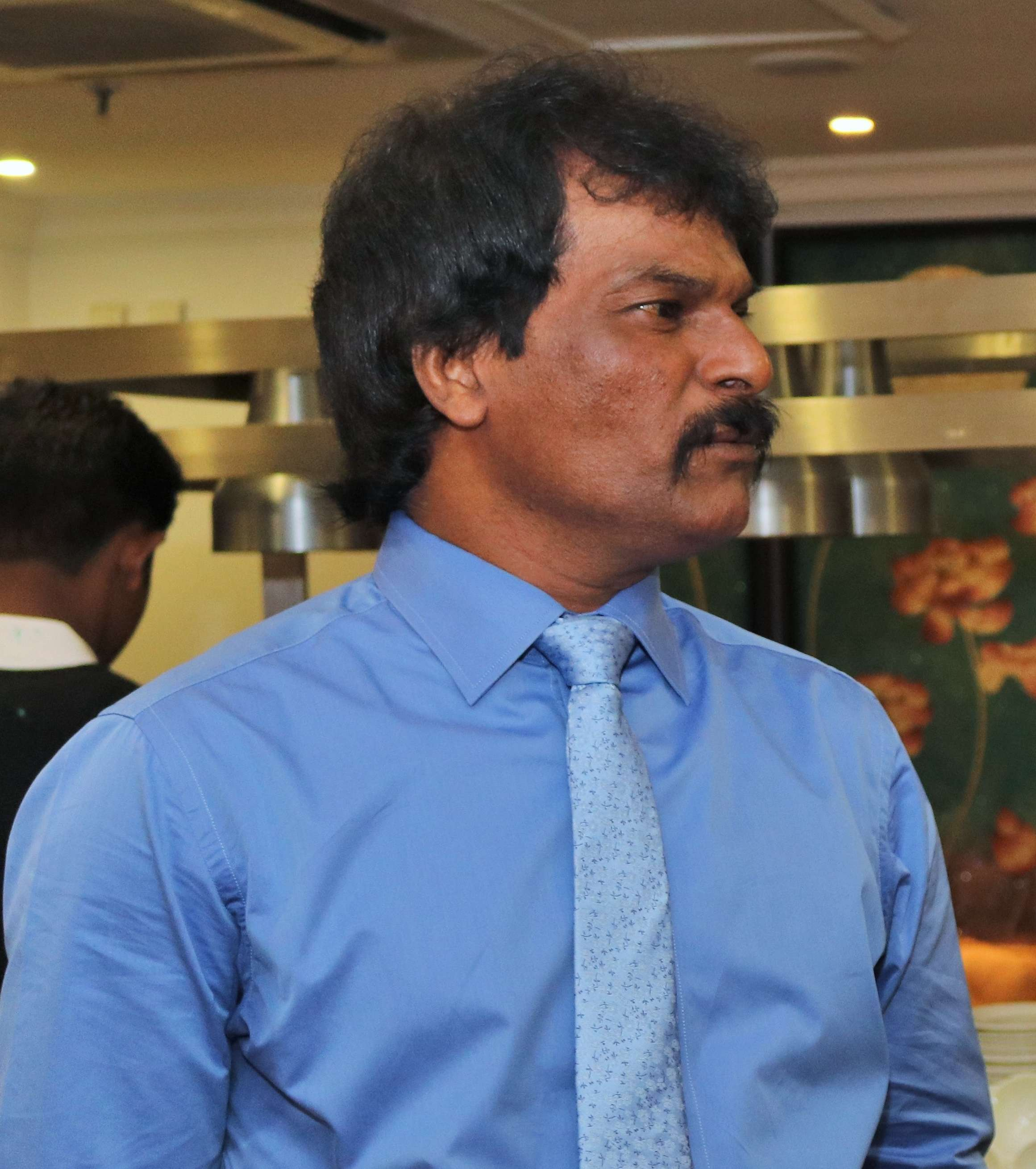 Dhanraj Pillay talking to a member of the organisers - Copy