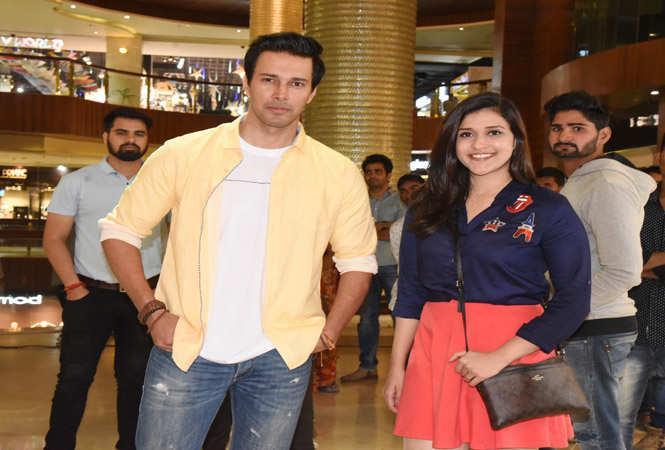 Actors Rajniesh Duggall and Mannara Chopra posing for shutterbugs