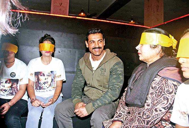 Survivors were given a surprise when they were made to sit blindfolded, and much to their delight, when their blindfolds were removed, they saw John Abraham sitting with them (BCCL/ Aditya Yadav)