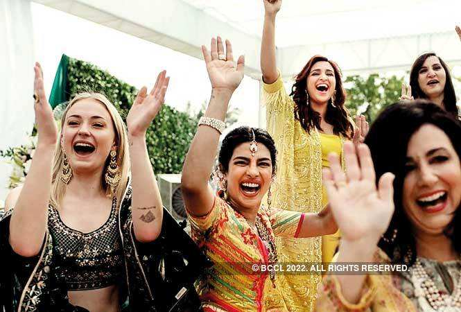 Priyanka Chopra chilling with Parineeti and Sophie Turner, who wore a bottle green lehenga, which she teamed up with huge earrings