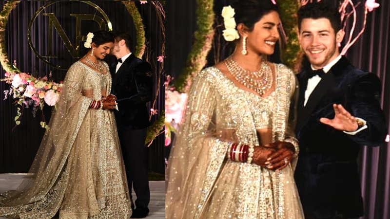 Priyanka Chopra and Nick Jonas pose for cameras at their wedding reception in Delhi