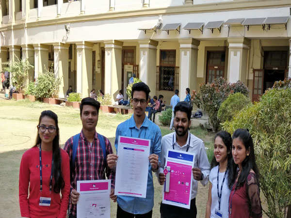 Students-holding-posters-in-the-campus