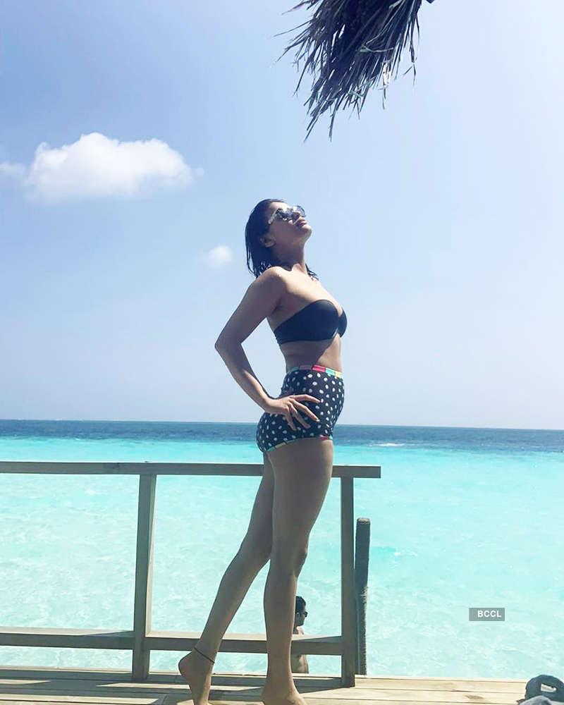 Blue-eyed girl Sneha Ullal is raising temperatures in Maldives