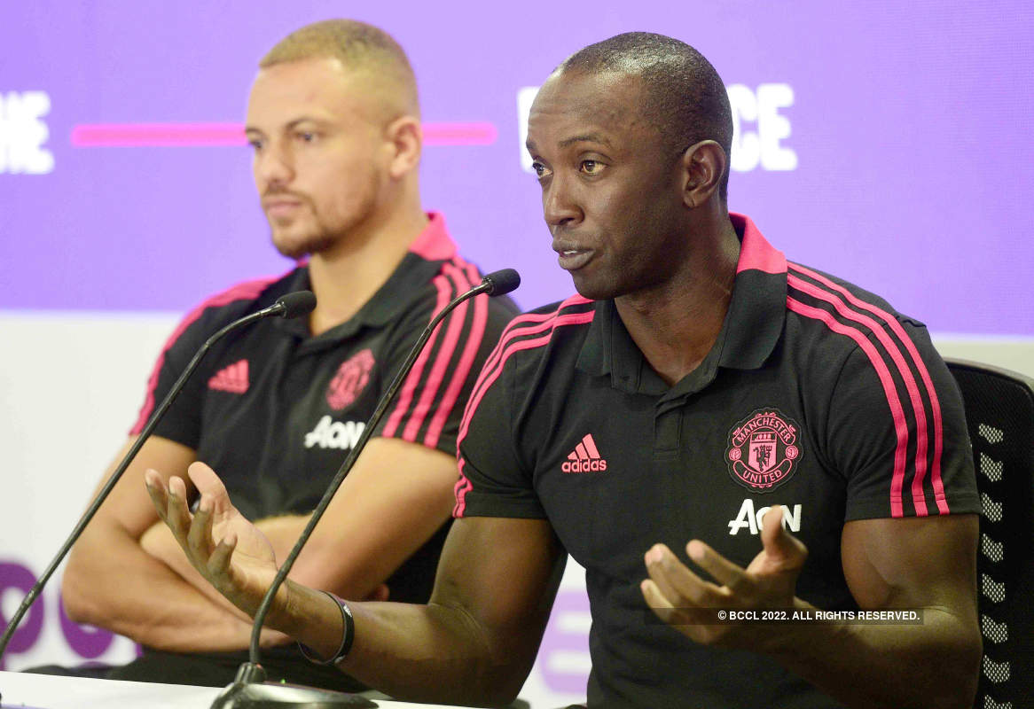 Manchester United players Wes Brown and Dwight Yorke attend a promotional event