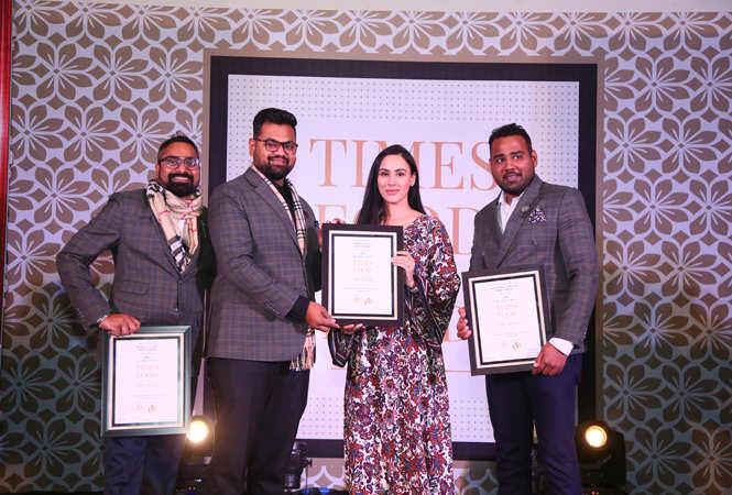 Restrurateurs of the Year Miss India UK 2012 Deana Uppal gives away the award to (L-R) Kushal Sushil, Sankalp Gupta and Raunak Khandelwal of Nibs Cafe & Chocolataria