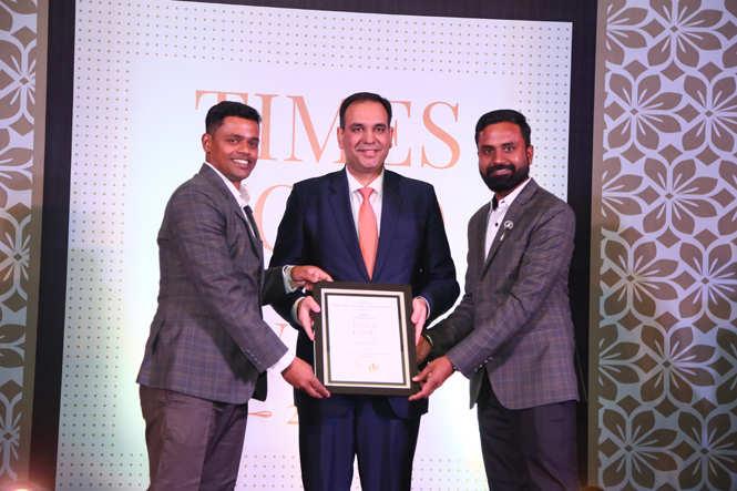 Best Cafe (Casual) Nibs Cafe And Chocolataria-Chef Manu Murlidharan (L) and Sunil Lohiya receive the award from Vishvapreet Singh Cheema, General Manager, Crowne Plaza Jaipur Tonk Road