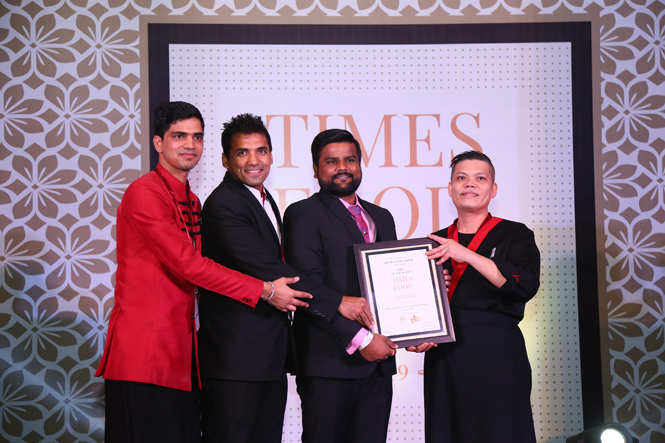 Best Chinese (Premium) House OF Han Sandeep Kumar, Virendra Prakash and Chef Lee Tuck receive the award from  archer Rajat Chauhan