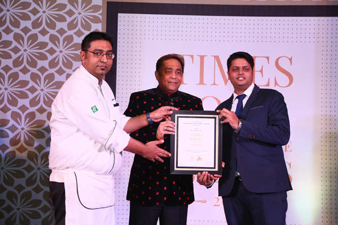 Best Restobar (Nightlife) Roadhouse Bar & Grill -Executive chef Arindam Bahel (L) and Mohit Bhargava receive the award from educationist Sandeep Bakshi