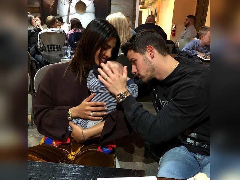 Photo Of Priyanka Chopra And Nick Jonas With A Cute Little Baby