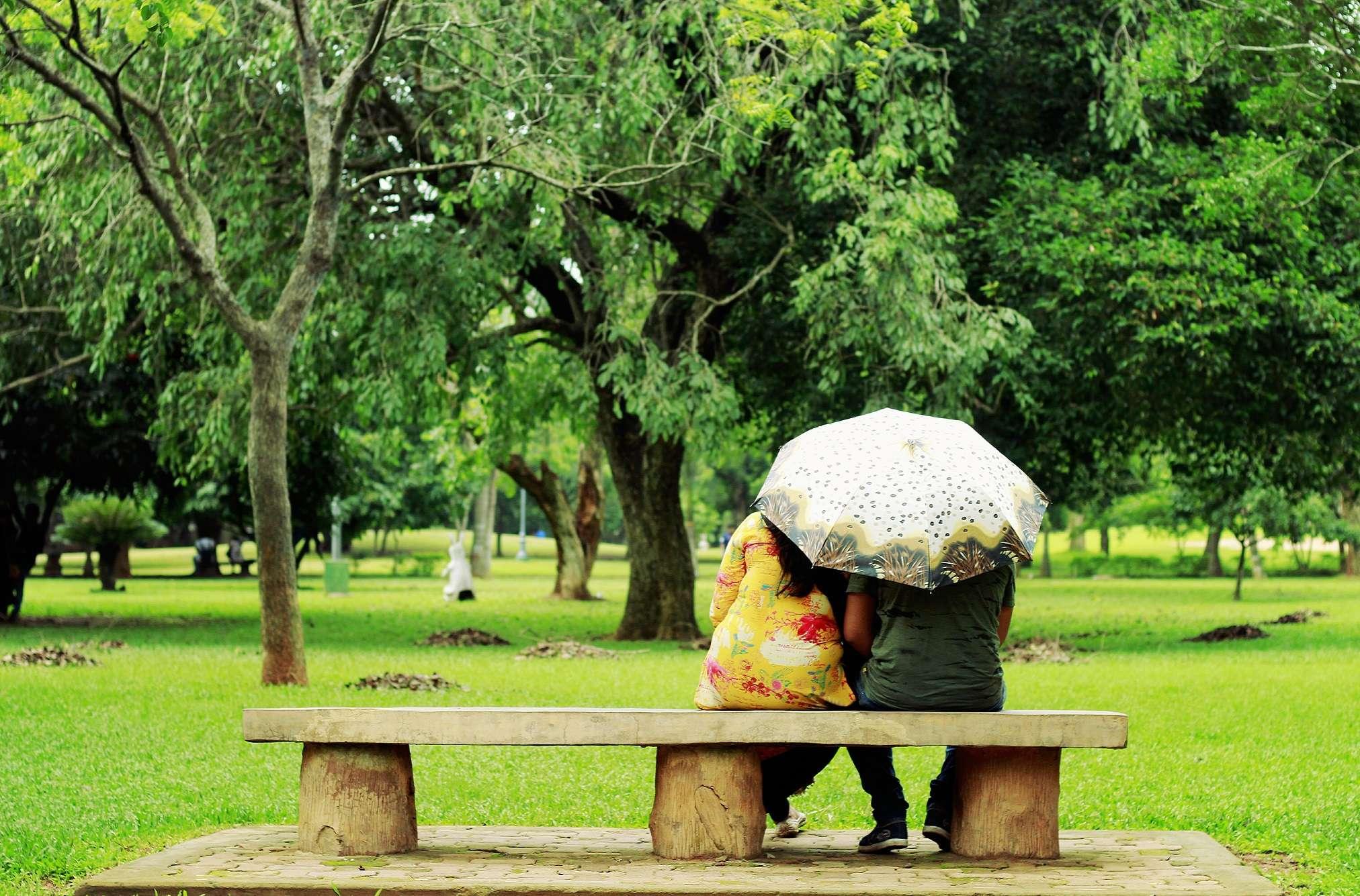a couple enjoying rain at a park - Copy