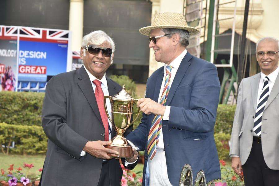 Subir Ranjan Dasgupta, owner of the winning horse Shivansh, recieves the cup from British Deputy High Commissioner Bruce Bucknell.