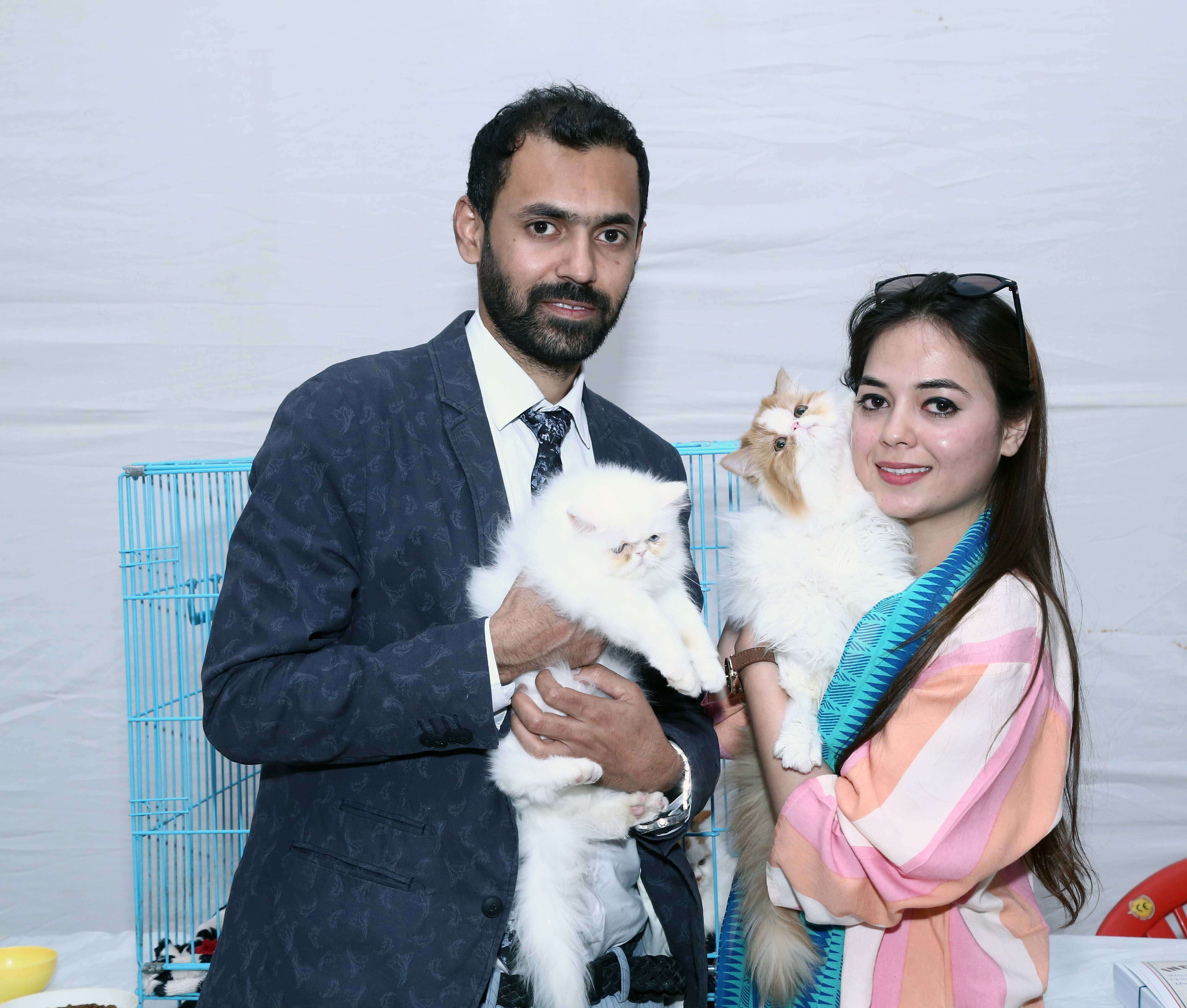 Uzair Khan and wife  with their cats
