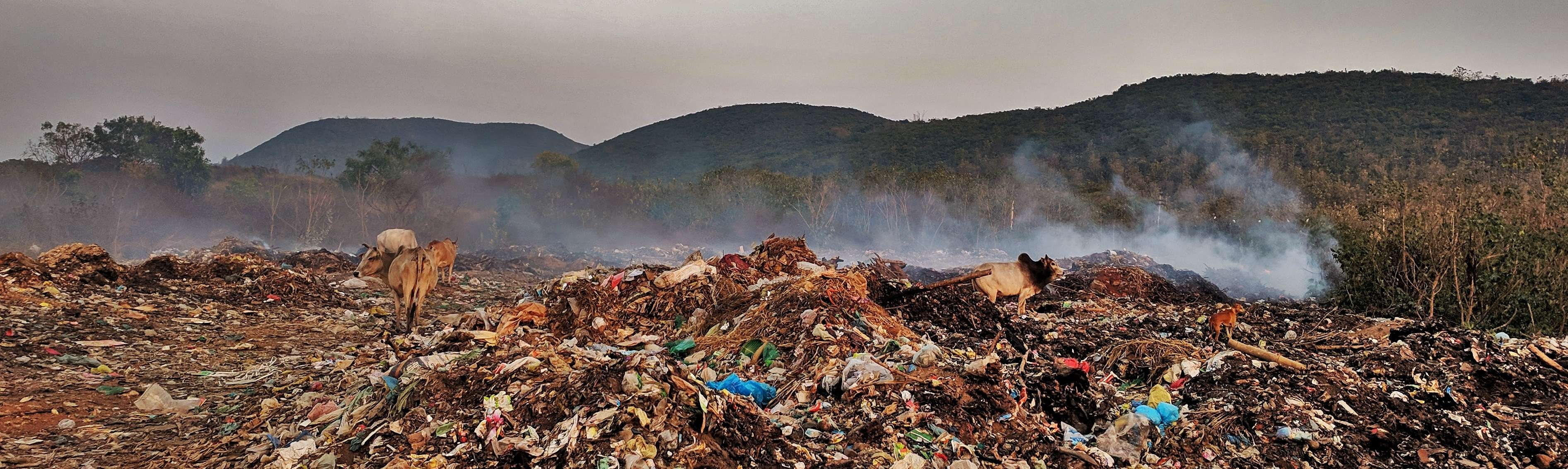 A dumping yard on fire creates air pollution - Copy
