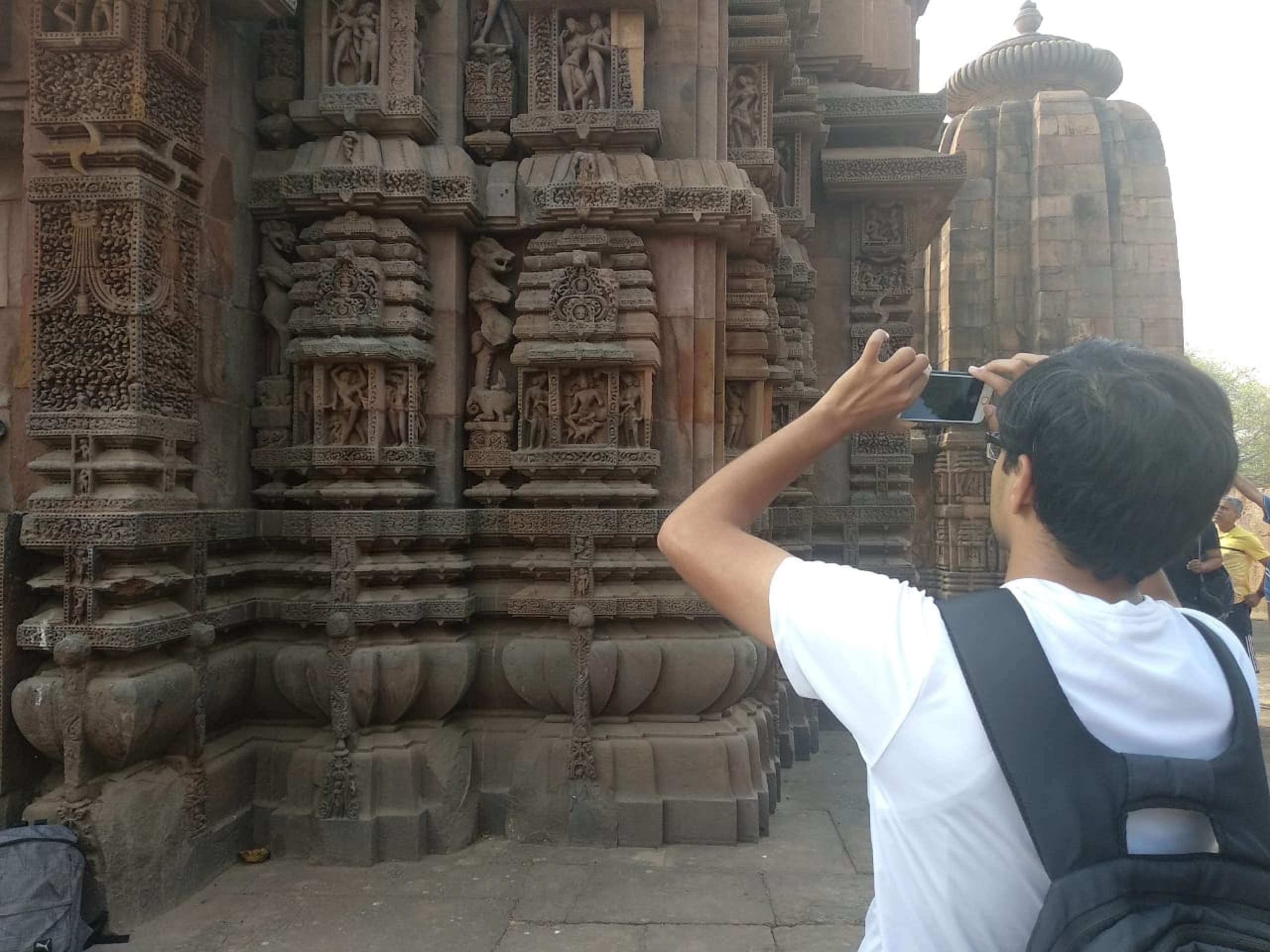 A girl takes pics of the sculptures.