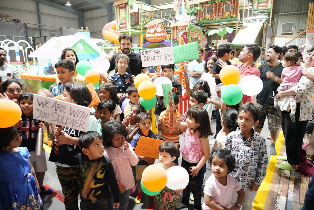 Seen Kids showing placards at Sim and Sam's Party&Plytown Kompally as a part of Play For CRPF program also seen Orgaisers in the pic -2