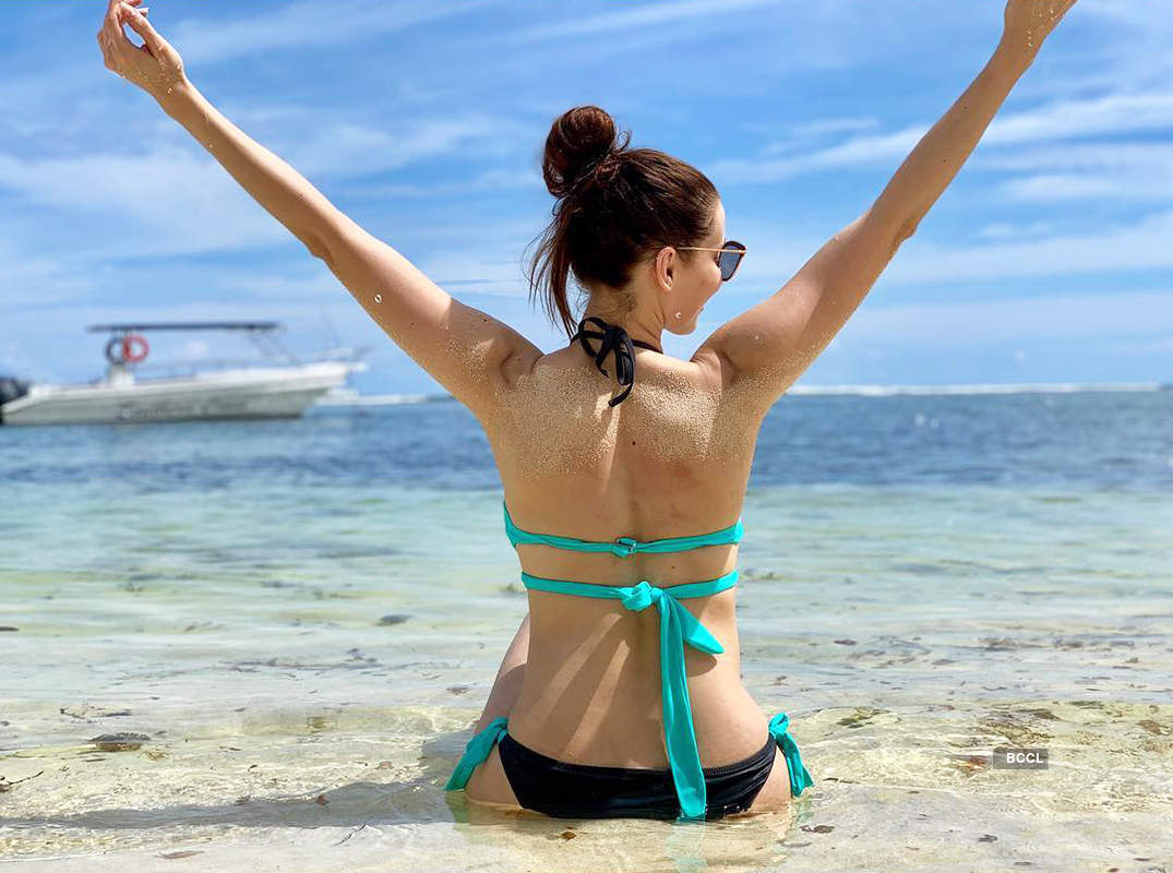 Claudia Ciesla is making heads turn with her beach vacation pictures
