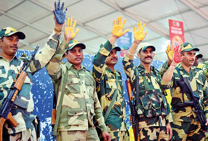 Paramilitary personnel participating in the handprint painting record at the Kumbh (BCCL/ Pankaj Singh)