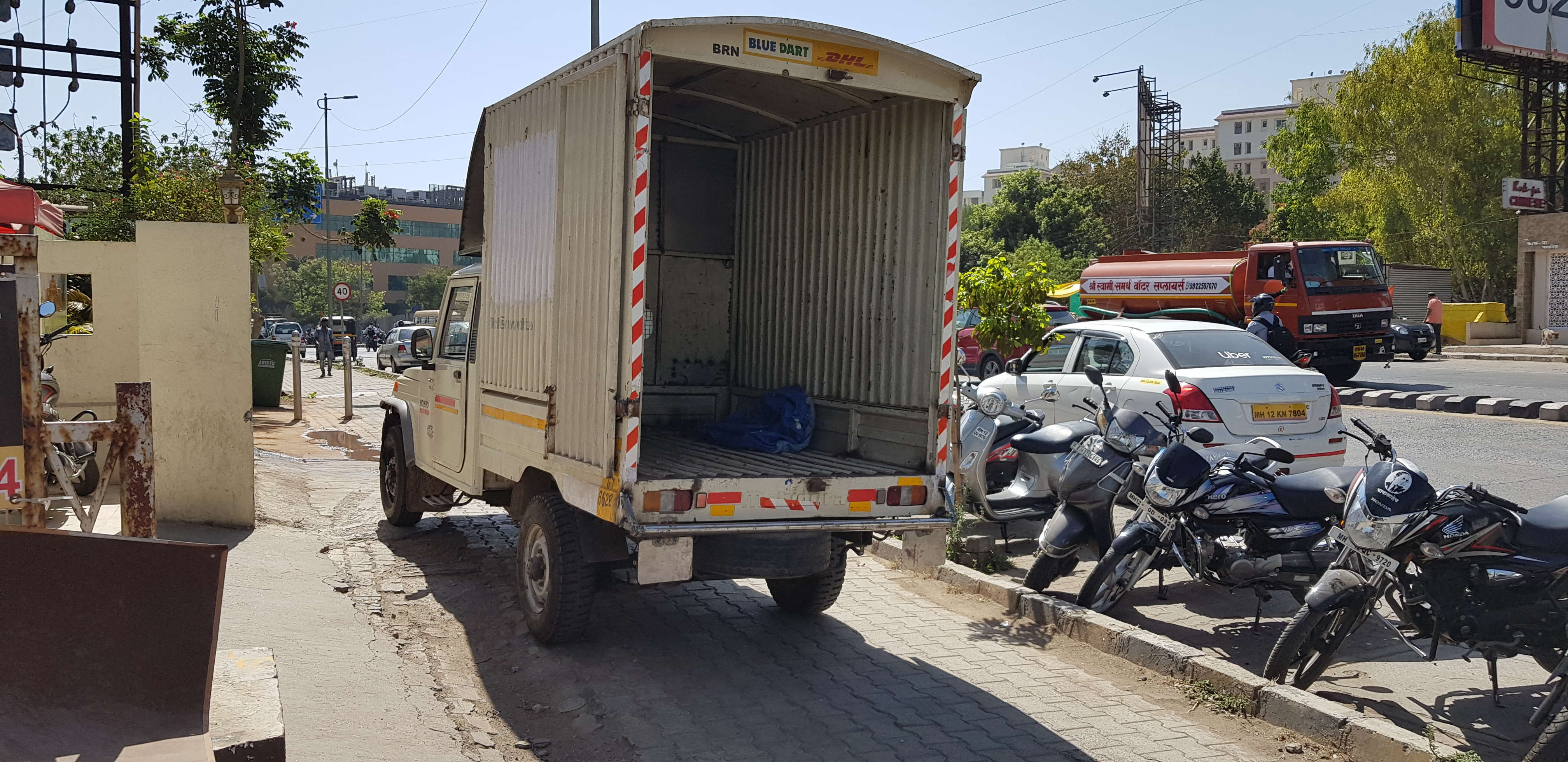 parking ON footpath Blue Dart Courier truck - Times of India
