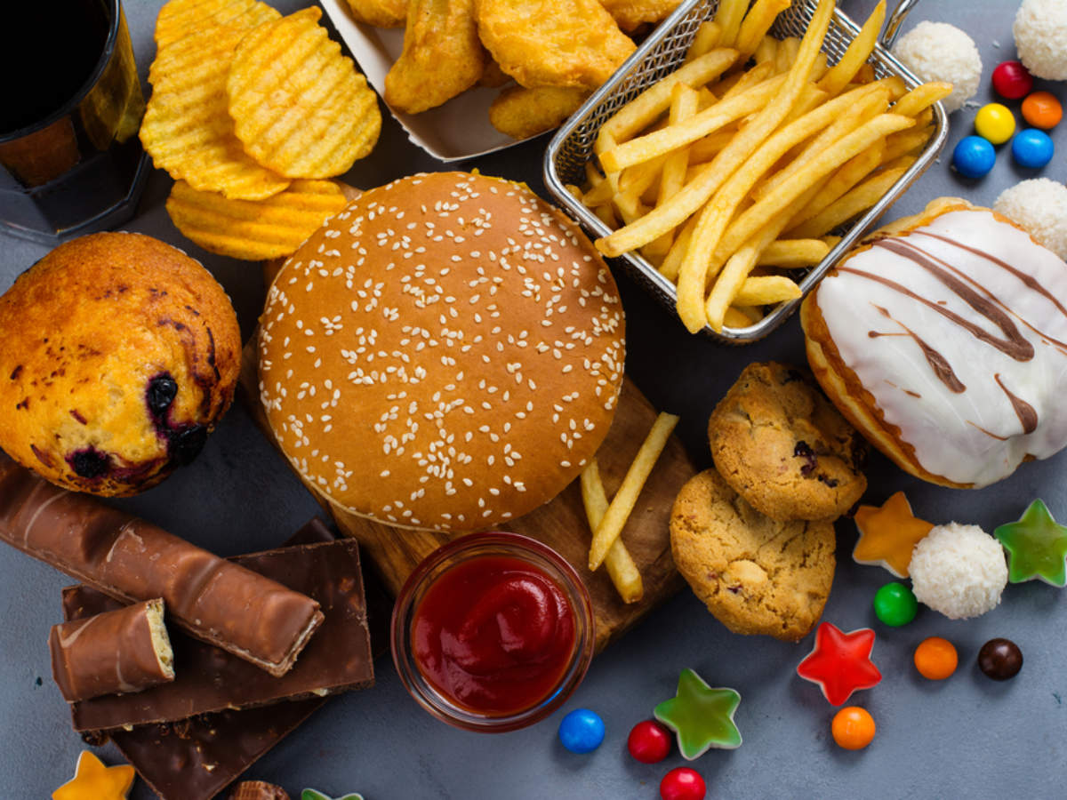 various foods such as burgers snacks and fries on a table