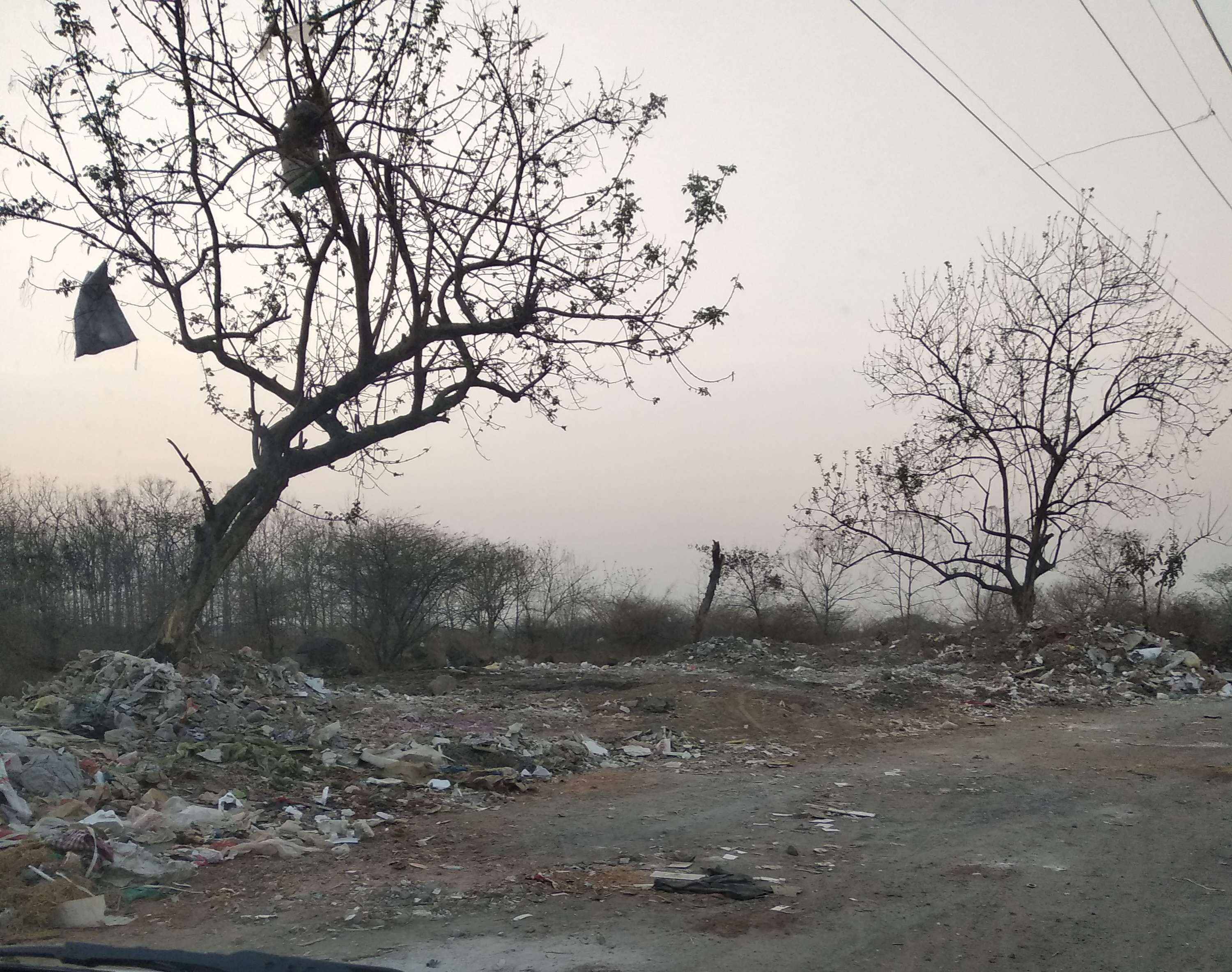 Construction and garbage dump - Times of India