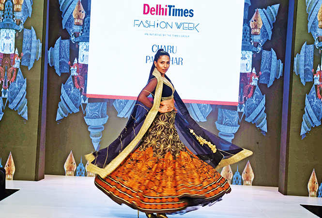 ​Candice Pinto​ walks the ramp for Charu Parashar