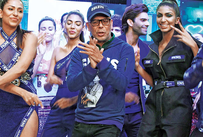 Designer Narendra Kumar danced his way on to the ramp with his models