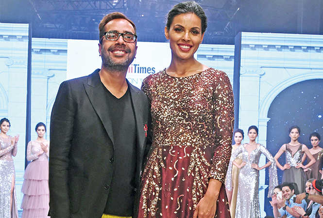 Ashfaque Ahmed with showstopper Deepti Gujral