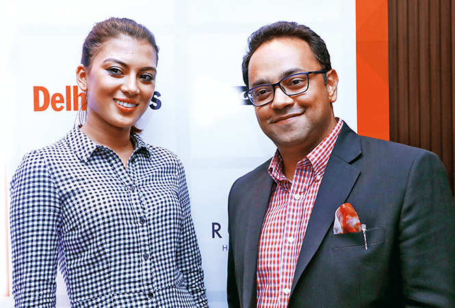 ​Parmila Chettri, fbb Colors Femina Miss India Sikkim 2018, and Abhishek Sansi, Managing Director, Indicolour​