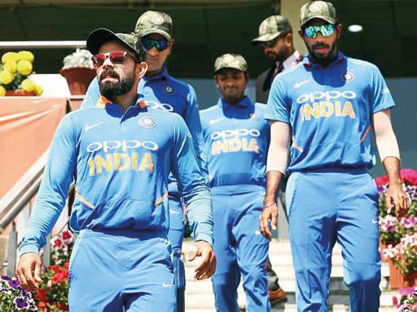 The Indian Cricket team sporting camouflage caps